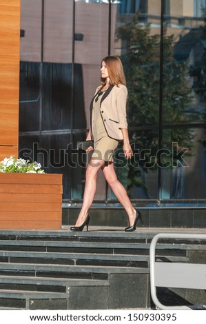 Portrait of a cute business woman over business center on background - stock photo