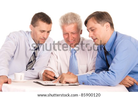 portrait of a cute businessmen at table - stock photo