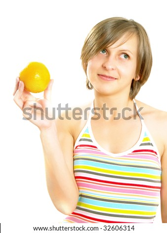 Portrait of a cute Caucasian blond girl with a nice colorful striped dress who is smiling and she is holding a fresh orange in her hand. Isolated on white.