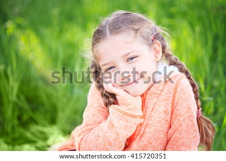 Portrait of a cute cheerful girl on the nature - stock photo