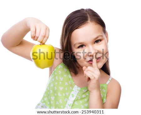 Portrait of a cute cheerful girl with green apple, isolated over white - stock photo