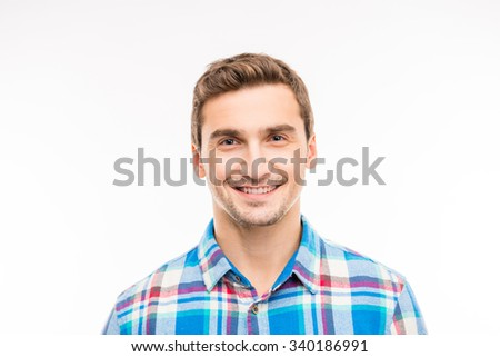 Portrait of a cute cheerful handsome young man - stock photo