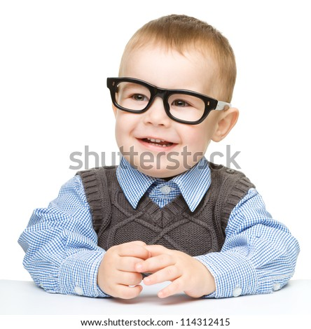 Portrait of a cute cheerful little boy wearing glasses, isolated over white - stock photo