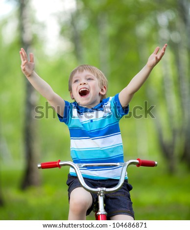 Portrait of a cute child boy on bicycle - stock photo