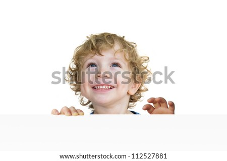 Portrait of a cute child looking up and laughing - stock photo