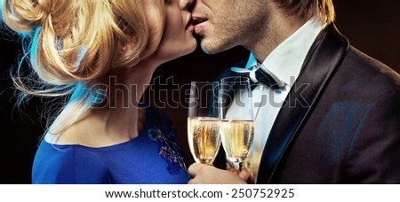 Portrait of a cute  couple drinking champagne - stock photo