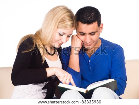 portrait of a cute couple reading a book