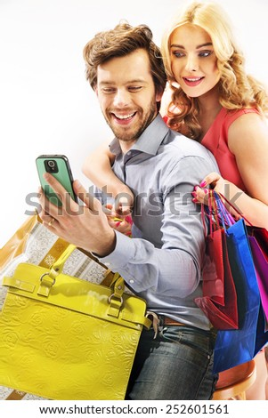 Portrait of a cute couple watching on smartphone - stock photo