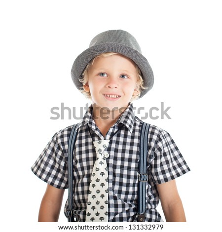 Portrait of a cute curly blond European boy wearing a plaid shirt, tie and hat. Studio shot, isolated on white background. - stock photo