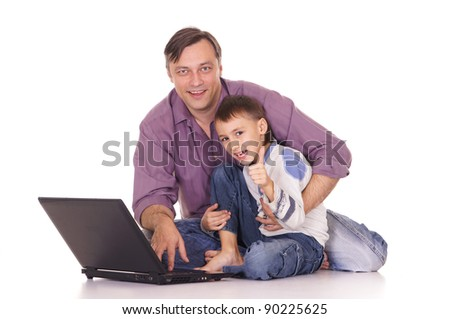 portrait of a cute dad and son with laptop