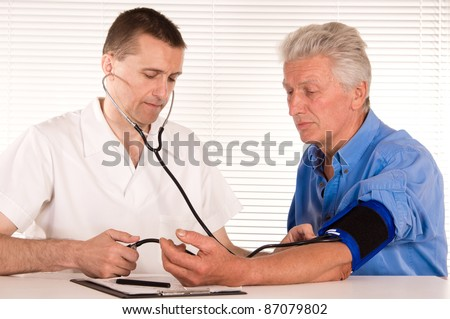 portrait of a cute doctor with aged patient