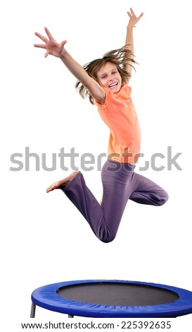 Portrait of a cute elementary girl jumping and dancing.  Isolated over white background - stock photo