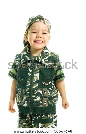 portrait of a cute excited three year old boy dressed in camouflage - stock photo
