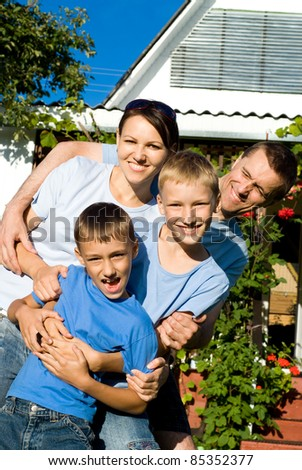 portrait of a cute family at house
