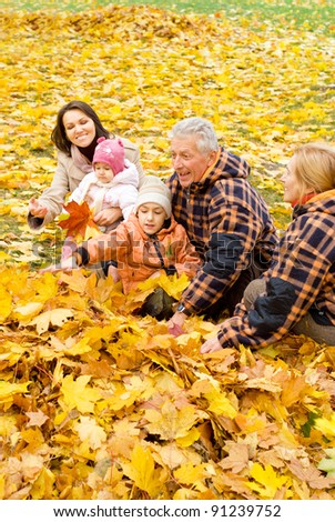 portrait of a cute family in autumn park - stock photo