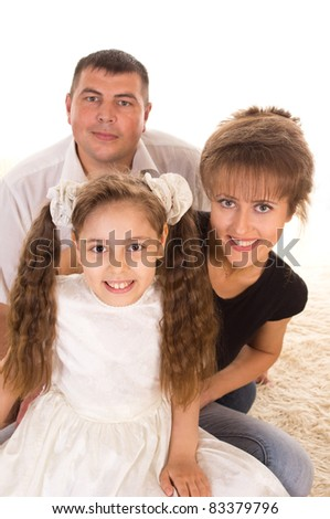 portrait of a cute family on a carpet