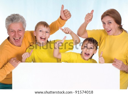 portrait of a cute family with board