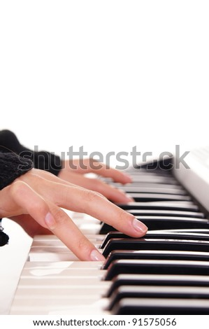 portrait of a cute fingers and piano keys