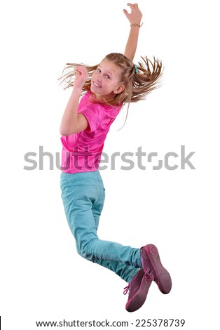Portrait of a cute girl jumping and dancing.  Isolated over white background - stock photo