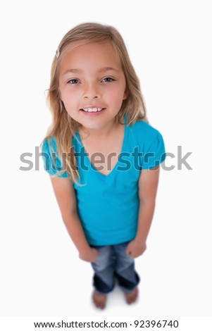 Portrait of a cute girl looking at the camera against a white background - stock photo