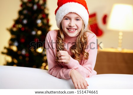 Portrait of a cute girl on a Christmas eve being excited about celebration - stock photo