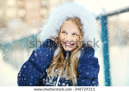 portrait of a cute girl on a walk in the winter. teen outdoors