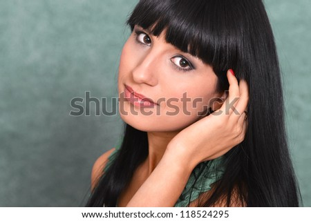 portrait of a cute girl posing on a green background - stock photo