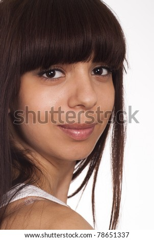 portrait of a cute girl posing on a white