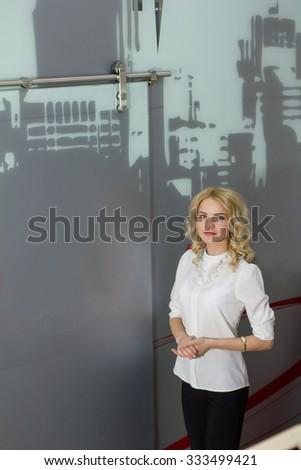 portrait of a cute girl realtor in office - stock photo