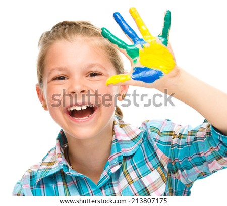 Portrait of a cute girl showing her hand painted in bright colors, isolated over white