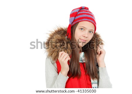 Portrait of a cute girl teenager wearing warm clothes.