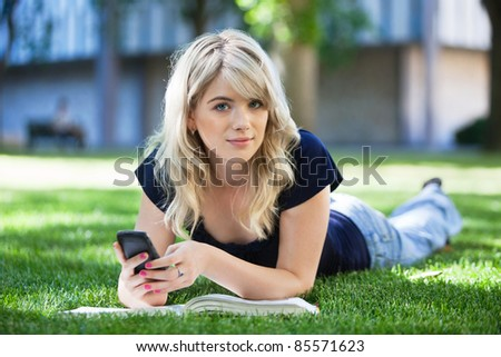 Portrait of a cute girl using cell phone - stock photo
