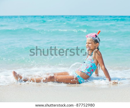 Portrait of a cute girl wearing a mask for diving background of the sea - stock photo