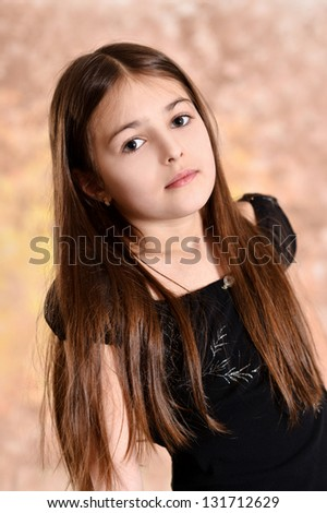 portrait of a cute girl with brown hair on a beautiful background