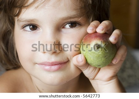 Portrait Of A Cute Girl With Pear (focus on eyes) - stock photo