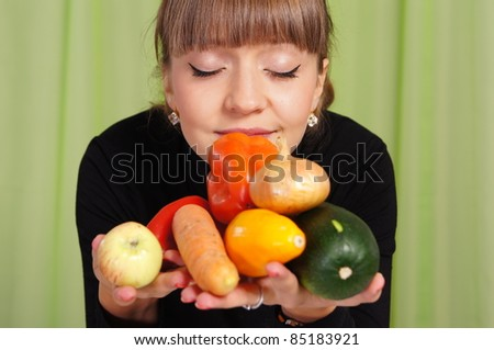 portrait of a cute girl with vegetables