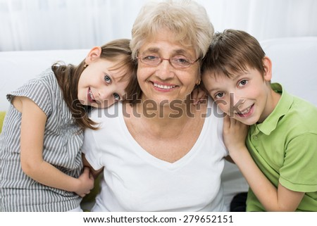 portrait of a cute grandchildren with grandmother - stock photo