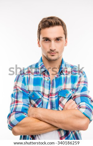 Portrait of a cute handsome young man crossing hands