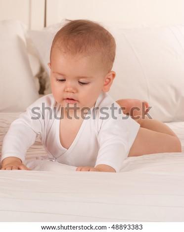 Portrait of a cute happy baby in a bodysuit - stock photo