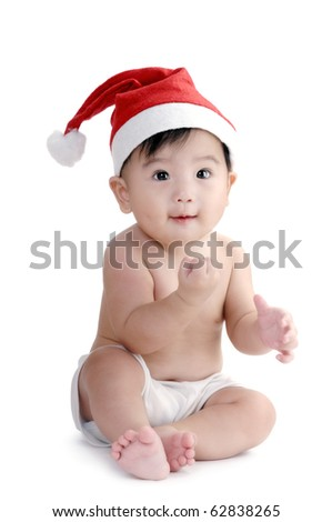 Portrait of a cute infant baby wearing Santa hat over white background. - stock photo