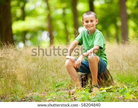 Portrait of a cute kid outdoor enjoying nature - stock photo