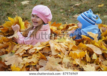 portrait of a cute kids in leaves - stock photo