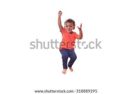 Portrait of a cute little African American boy jumping on a trampoline - stock photo