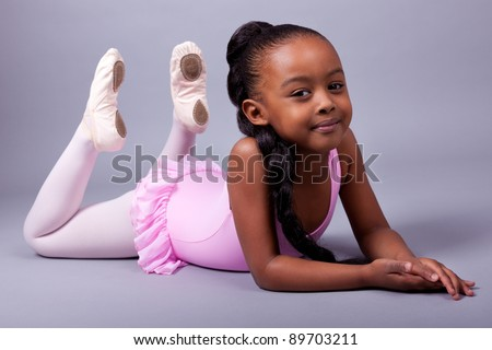 Portrait of a cute little African American girl wearing a ballet costume - stock photo