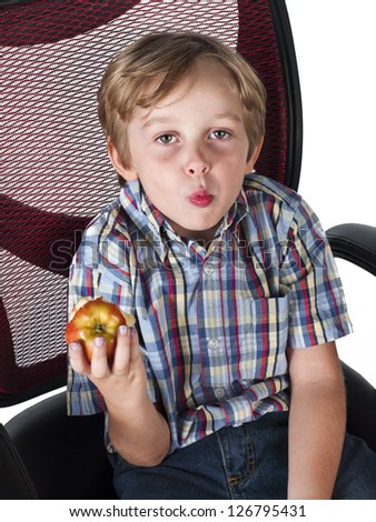Portrait of a cute little boy eating apple,
