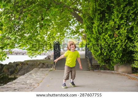 Portrait of a cute little boy having fun outdoors - stock photo