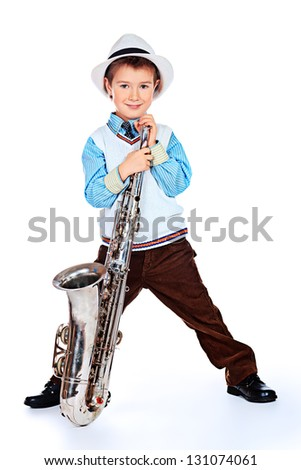 Portrait of a cute little boy jazzman playing his saxophone. Isolated over white. - stock photo
