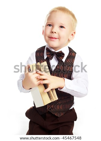 portrait of a cute little boy with a dictionary