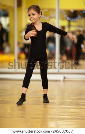Portrait of a cute little caucasian girl dancing - stock photo
