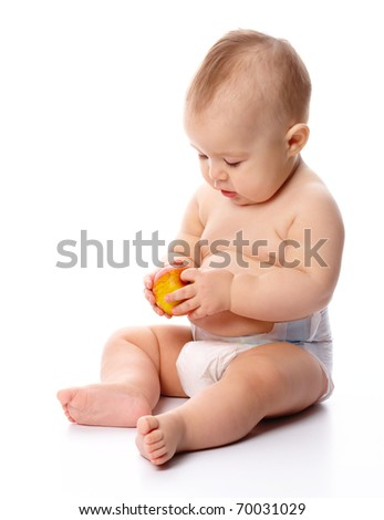 Portrait of a cute little child with red apple, isolated over white